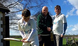 Wetherby CC's 11-year-old Jack Dyson tries out the new coaching mat with Coaching Mat's David Cooper (L) and Wetherby CC's Arthur Probert (R) looking