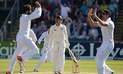 Moeen Ali (left) celebrating the wicket of Michael Clarke (centre) with Alastair Cook (right).