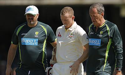 Chris Rogers walks off the field after retiring hurt in the second innings of the second Test at Lord's.