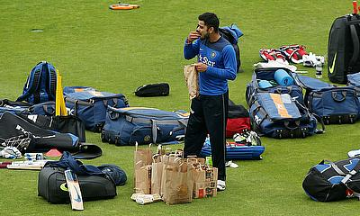 Virat Kohli grabs some food