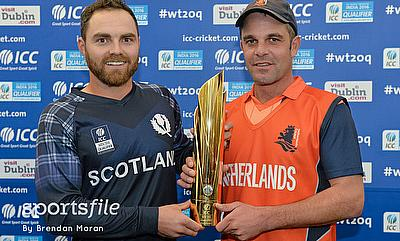Team captains Preston Mommsen (left), Scotland, and Peter Borren (right), Netherlands, share the trophy after the Final was abandoned due to rain befo