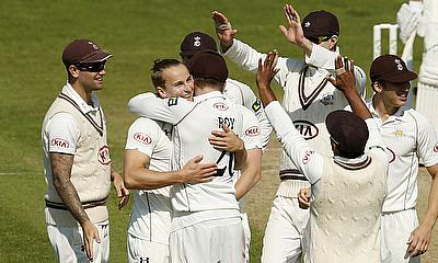 Surrey players celebrate a wicket