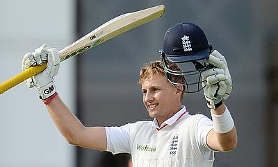 Joe Root celebrates after making a century
