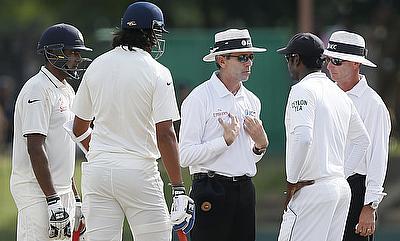 Umpire Nigel Llong (centre) talks to Sri Lankan captain Angelo Mathews (2nd right) after a heated exchange between Ishant Sharma (2nd left) and Dhammi