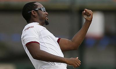 Jomel Warrican celebrates the wicket of Milinda Siriwardana on day one of the second Test in Colombo
