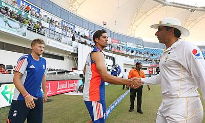 Alastair Cook (centre) and Misbah-ul-Haq (right) shake hands following the second Test in Dubai