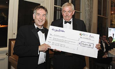 Simon Fielder hands over the cheque to PCA Benevolent Fund President David Graveney OBE