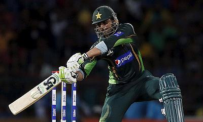 Fifties from Malik, Akmal rescue Pakistan after Javed scare