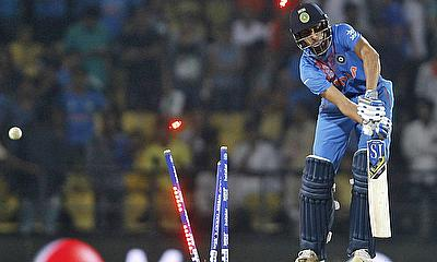 Ashish Nehra is bowled, and the tournament is thrown wide open