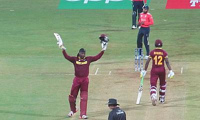 Chris Gayle celebrates his 47-ball century against England in Mumbai