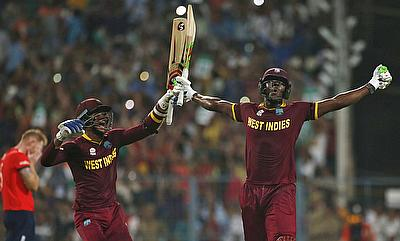 Marlon Samuels (left) and Carlos Brathwaite (right) celebrating the ICC World T20 win over England.