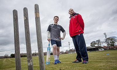 Kyle Coetzer pictured with Alasdair Appleby, a current student