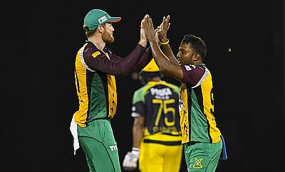 Veerasammy Permaul (right) picked three wickets for the Guyana Amazon Warriors.