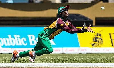 Guyana have been excellent in the field - here Jason Mohammed swoops to catch Devon Thomas against St Kitts