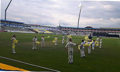 The Penkridge CC juniors perform their flag-bearing duties