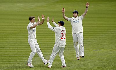 Glamorgan players celebrate a wicket