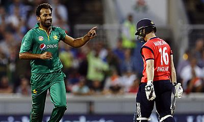 Wahab Riaz (left) celebrating the wicket of Eoin Morgan (right).