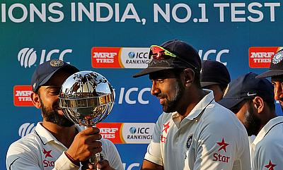 Ravichandran Ashwin (right) holding the Test mace which was awarded after India reclaimed number one position in ICC Test rankings