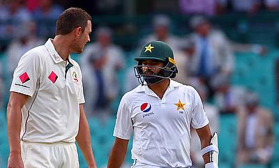 Josh Hazlewood (left) and Azhar Ali in a conversation at the end of second day's play