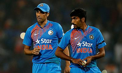 Jasprit Bumrah (right) and Ashish Nehra shared five wickets between them
