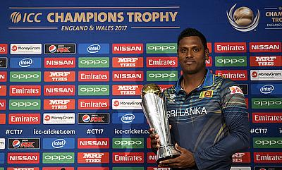 Sri Lanka's Angelo Mathews poses with the ICC Champions Trophy during the press conference