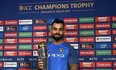 ndia's Virat Kohli poses with the ICC Champions Trophy during the press conference