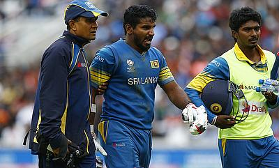 Kusal Perera (centre) leaving the field during the game against India