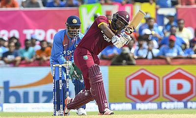 Evin Lewis (right) will open the innings for West Indies