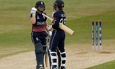 Tammy Beaumont (left) and Fran Wilson celebrating the win over New Zealand in the warm-up game