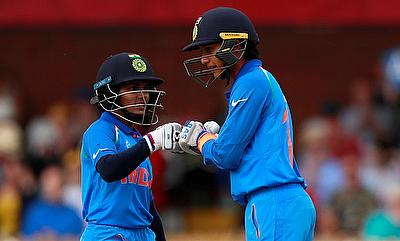 Smriti Mandhana (right) scored an unbeaten century against West Indies