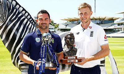 South Africa's Dean Elgar (L) and England's Joe Root pose with trophies