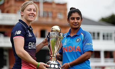 England's Heather Knight and India's Mithali Raj pose with the trophy