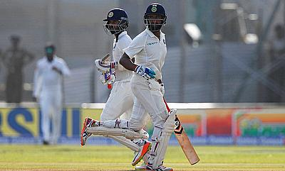 Shikhar Dhawan (left) and Cheteshwar Pujara in action on day one in Galle