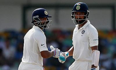 Ajinkya Rahane (left) and Cheteshwar Pujara (right) in action on opening day of Colombo Test