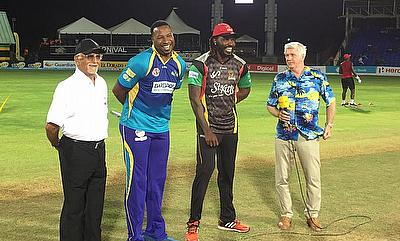 Chris Gayle and Kieron Pollard during the toss