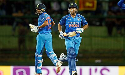 India's MS Dhoni and Bhuvneshwar Kumar run between wickets in Pallekele