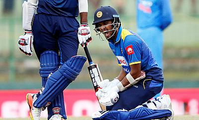 Dinesh Chandimal's (right) reacts after getting injured in the third ODI