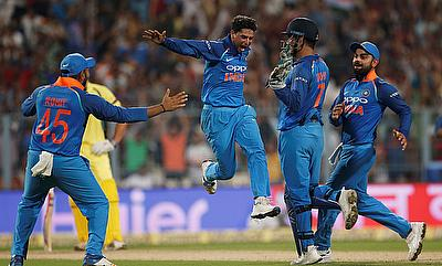 Kuldeep Yadav (centre) was among the wickets once again