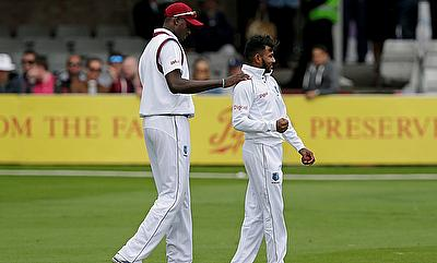 Devendra Bishoo (right) led West Indies' fightback with a five-fer