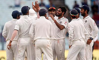 Bhuvneshwar Kumar (centre) picked eight wickets in the game