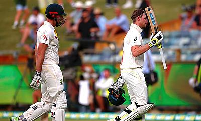 Steve Smith (right) walks in front of team mate Shaun Marsh as they walk off the ground at the end of the second day's play