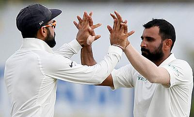 Virat Kohli (left) is confident of his team's chances in South Africa