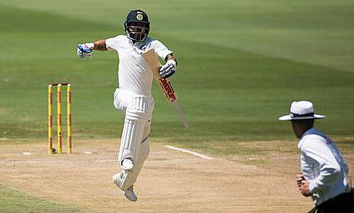 Virat Kohli (left) celebrating his century in the third day's play in Centurion