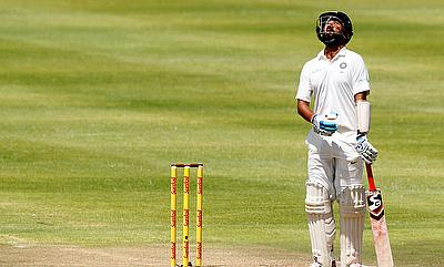 India's Cheteshwar Pujara reacts after being dismissed