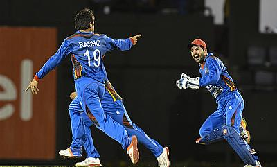 Rashid Khan (left) picked four wickets for Afghanistan
