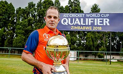 Peter Borren posing with the ICC World Cup Qualifiers 2018 trophy