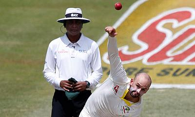 Nathan Lyon (right) picked three wickets in the Durban Test