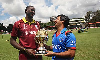 Jason Holder (left) and Asghar Stanikzai with the trophy