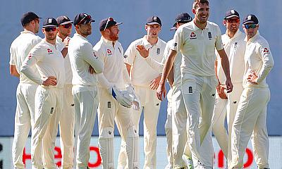 England's Craig Overton celebrates with team mates