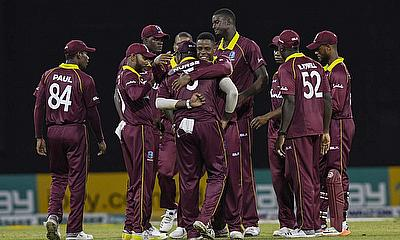 Windies players celebrate a wicket